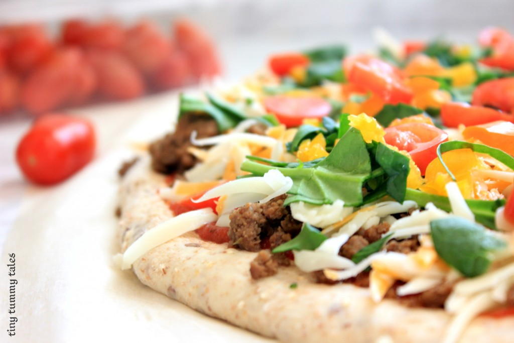 Rustic crust taco pizza! Whole wheat, flax, and quinoa in this crust make it extra nutritious, and the taco flavour makes it great for kids! Healthy kids meal:)